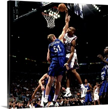 Vince Carter of the Toronto Raptors drives to the basket for a slam dunk
