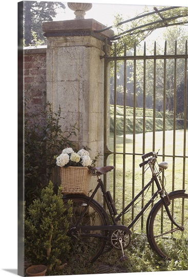 Vintage bicycle leaning against wrought iron gate photo - Wrought iron bicycle wall art ...