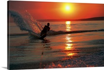 Waterskiing at sunset