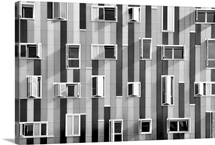 Windows in modern building with unusual distribution.