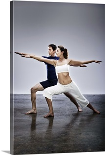 Woman and man in yoga pose