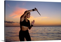 Woman doing martial arts at beach