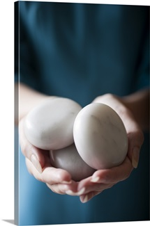 Woman holding massage rocks
