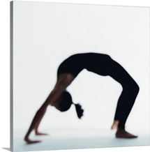 Woman in yoga backbend pose