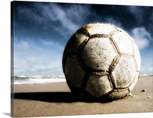 Worn and Old Soccer Ball on Sand