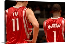 Yao Ming 11 and Tracy McGrady 1 of the Houston Rockets stand together during their game