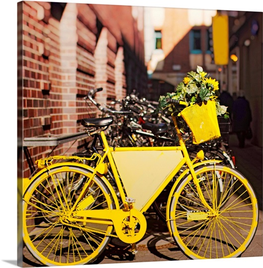 yellow bike with sunflowers parked outside photo canvas print great big canvas. Black Bedroom Furniture Sets. Home Design Ideas