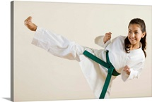 Young girl doing karate kick