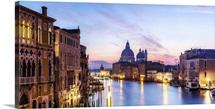 Italy, Veneto, Venice. Santa Maria della Salute church and Grand Canal at sunrise