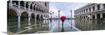 Italy, Veneto, Venice. Woman with red umbrella