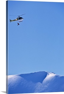 Snowboarder being dropped from a helicopter; Self Portrait, Haines, Alaska