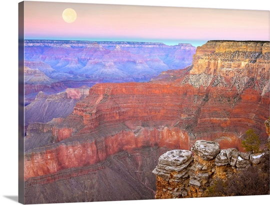 Full moon over the Grand Canyon at sunset as seen from Pima Point Arizona
