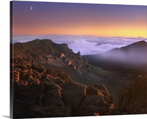 Sunrise and crescent moon overlooking Haleakala Crater, Maui, Hawaii