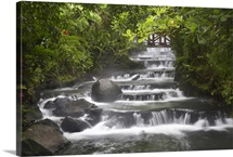 Tabacon River, cascades and pools in the rainforest, Costa Rica