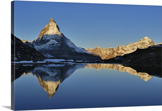 The Matterhorn Reflected In The Riffelsee Lake At Sunrise