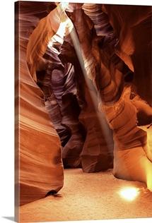 A beam of sunlight shining into the Antelope Canyon slot canyon