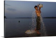 A Burmese laborer bathes in the Irrawaddy River near Mandalay