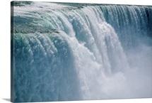 A cascade of water thunders over Niagara Falls