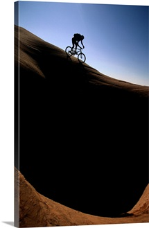 A cyclist riding on the slick rock of northern Arizona