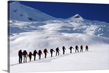 A group of back country skiiers on a glacier