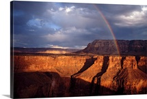 A rainbow arches over the Grand Canyon