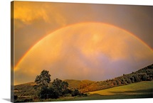 A rainbow over hay fields near Bozeman, Montana