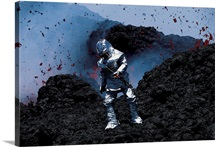 A scientist in a thermal suit and helmet collects samples of lava