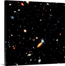 A shot of a deep space photograph flecked with galaxies