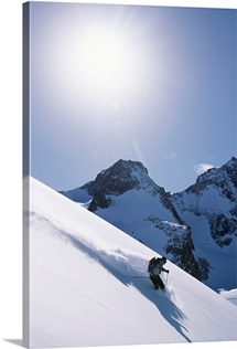 A skier in the Selkirk Range, British Columbia, Canada