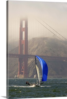 A Skiff sails in the San Francisco Bay near the Golden Gate Bridge