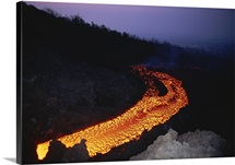 A stream of glowing lava trails down Mount Etna