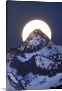 A Super Moon setting behind snow-dusted Capital Peak