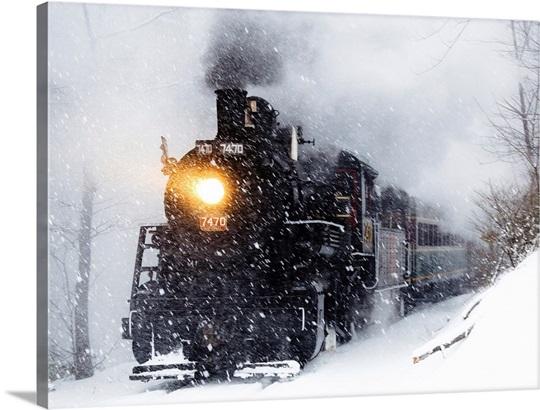 A Train Travels Through A Snow Storm Photo Canvas Print