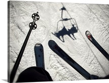 A view from the ski lift in Vail Colorado showing skis and poles
