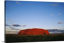 A view of Ayers Rock under a twilight sky