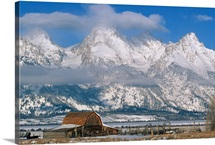 A view of the Mormon Row Barn and the Grand Tetons, Wyoming
