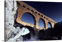 A view of the Pont du Gard aqueduct reflected on water, Nimes, France