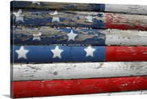 A weathered but patriotic detail of an old roadside fence