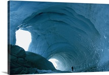 An enormous icy tunnel that looks like the inside of a cave