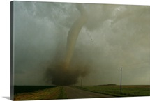 An F4 category tornado barrels down a rural South Dakota road