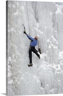 An ice climber negotiates a wall of ice