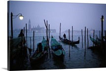 At the end of another long day, gondoliers ready their boats, Venice, Italy