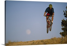 Biker catches some air, Oregon Basin, Wyoming