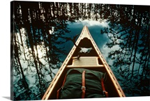 Bow of a canoe set against reflected trees, Georgia
