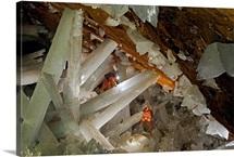 Cavers climbing a web of gypsum crystals