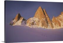 Climbers approaching Mount Fitzroy in morning light