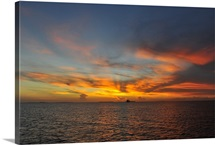 Dramatic Key West sunset with a ship in the horizon