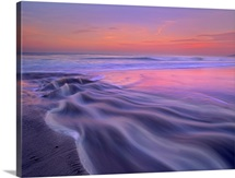 Fresh water stream flowing into the Pacific Ocean, Zuma Beach, Malibu, California