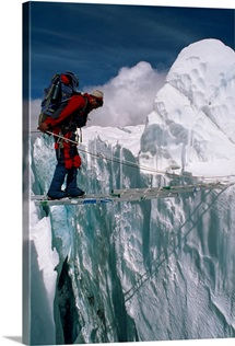 Fura Gyaljen, traverses a ladder on the Khumbu Ice Fall of Mount Eve rest, Nepal