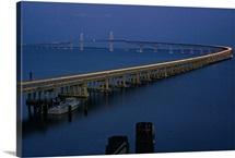 Headlights and taillights weave ribbon of light on bridge at twilight, Maryland
